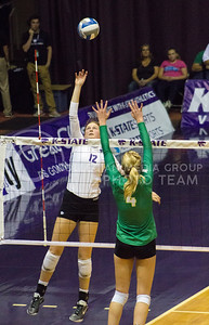 Middle blocker Macy Flowers tips the ball in the game against Baylor on Oct. 29, 2016, in Ahearn Field House. (Maddie Domnick | The Collegian)