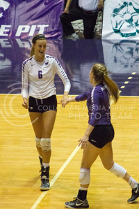 Senior setter Katie Brand high-fives senior libero Kersten Kober after winning a point in the game against Baylor on Oct. 29, 2016, in Ahearn Field House. (Maddie Domnick | The Collegian)