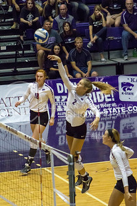 Freshman middle blocker Elle Sandbothe hits the ball in the game against Baylor on Oct. 29, 2016, in Ahearn Field House. (Maddie Domnick | The Collegian)