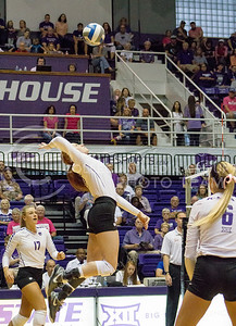 Junior opposite hitter Bryna Vogel hits the ball in the K-State game against Texas on Oct. 1, 2016, in Ahearn Field House. (Maddie Domnick | The Collegian)