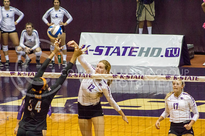 Sophomore middle blocker Macy Flowers hits the ball in the K-State game against Texas on Oct. 1, 2016, in Ahearn Field House. (Maddie Domnick | The Collegian)