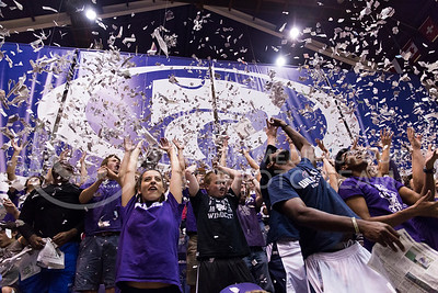 K-State fans throw newspapers in the air before the K-State volleyball game against Texas in Ahearn Field House on Oct. 1, 2016. (Anna Spexarth | The Collegian)
