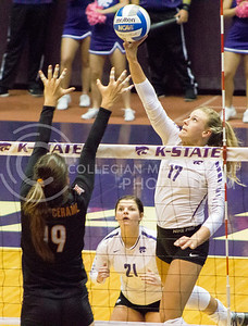 Senior outside hitter Brooke Sassin hits the ball in the K-State game against Texas on Oct. 1, 2016, in Ahearn Field House. (Maddie Domnick | The Collegian)