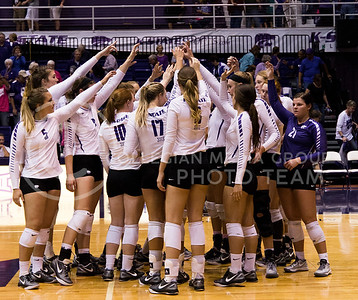 Members of the K-State volleyball team huddle up after their game against Texas in Ahearn Field House on Oct. 1, 2016. (Anna Spexarth | The Collegian)