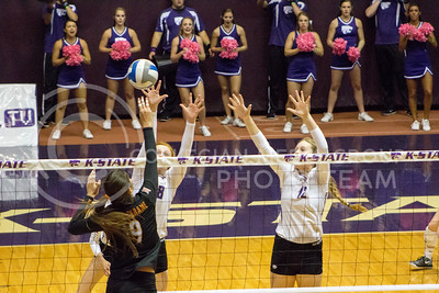 Junior opposite hitter Bryna Vogel and sophomore middle blocker Macy Flowers attempt to block the ball in the game against Texas on Oct. 1, 2016, in Ahearn Field House. (Maddie Domnick | The Collegian)
