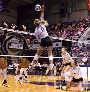 Senior opposite hitter Brooke Sassin hits the ball during the K-State volleyball match against Texas in Ahearn Field House on Oct. 1, 2016. (Anna Spexarth | The Collegian)