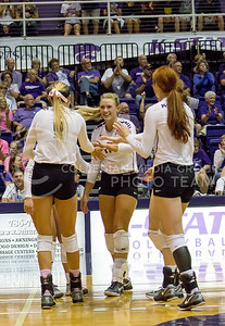 The K-State volleyball team celebrates a point against Texas on Oct. 1, 2016, in Ahearn Field House. (Maddie Domnick | The Collegian)