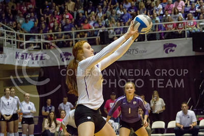 Junior opposite hitter Bryna Vogel  sets the ball in the K-State game against Texas on Oct. 1, 2016, in Ahearn Field House. (Maddie Domnick | The Collegian)