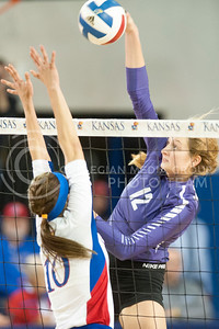Sophomore middle blocker Macy Flowers looks to hit the ball over KU players during the Sunflower Showdown on Oct.12, 2016 at Horesji Family Athletic Center. The Cats lost 3-0. (Evert Nelson | The Collegian)
