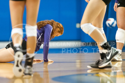 Junior opposite hitter Bryna Vogel is slow to get up after missing a point against KU during the Sunflower Showdown on Oct. 12, 2016, at the Horesji Family Athletic Center in Lawrence. The Wildcats lost 3-0. (Evert Nelson | The Collegian)