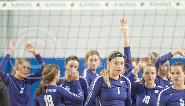 The Wildcats walk off the court at Horejsi Family Athletic Center in Lawrence after being defeated by KU at the Sunflower Showdown on Oct. 12, 2016. The Wildcats lost 3-0. (Evert Nelson | The Collegian)