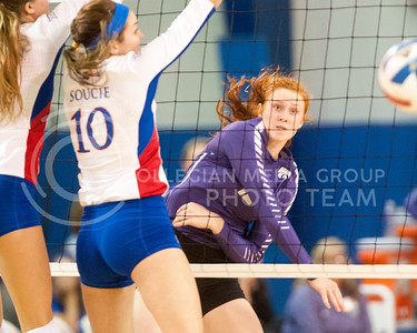 Junior opposite hitter Bryna Vogel lobs the ball over KU players during the Sunflower Showdown on Oct. 12, 2016, at Horejsi Family Athletic Center. The Wildcats lost 3-0. (Evert Nelson | The Collegian)