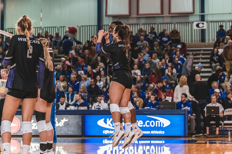 K-State setter Sarah Dixon and opposite Gloria Mutiri go in for a chest bump before the game against KU on November 14, 2018. The Wildcats defeated the Jayhawks 3-2 in Lawrence, KS. (Alex Todd | Collegian Media Group)