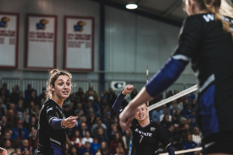 K-State's Jacque Smith points in celebration as Elle Sandbothe scores one of her 13 kills during Wednesday nights game against KU. K-State defeated the Jayhawks 3-2 in Lawrence, KS. (Alex Todd | Collegian Media Group)