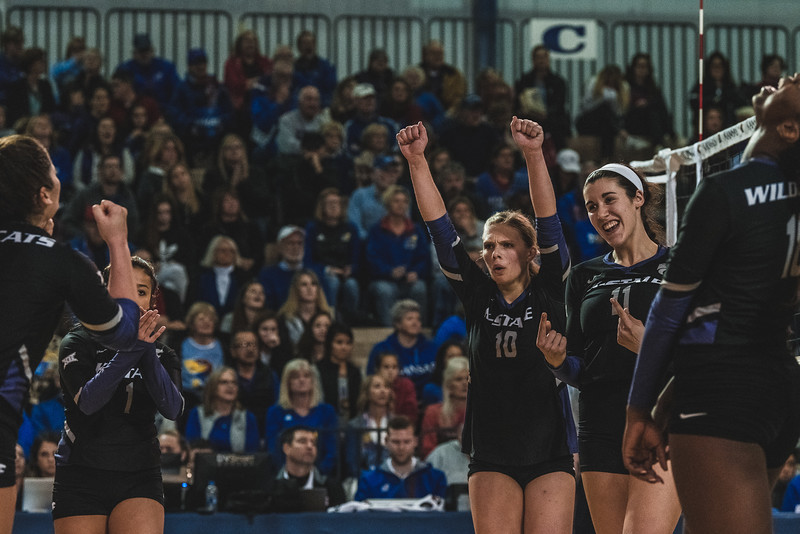 K-State redshirt freshman Brooke Heyne and redshirt sophomore Peyton Williams celebrate a kill during the fourth set against KU on Wednesday night. K-State defeated KU 3-2 in Lawrence, KS. (Alex Todd | Collegian Media Group)