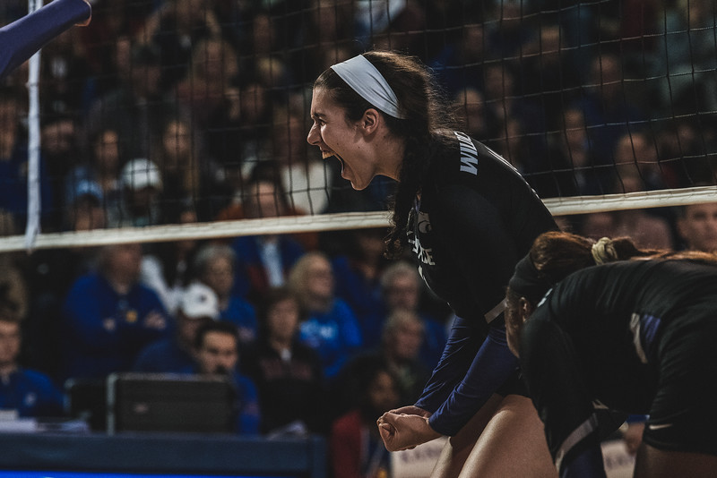 K-State redshirt sophomore Peyton Williams lets out a cry after scoring a kill against KU. The Wildcats defeated the Jayhawks 3-2 in Lawrence, KS on November 14, 2018. (Alex Todd | Collegian Media Group)