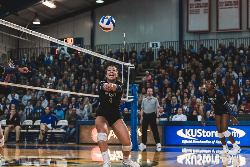 Keeping her eyes on the ball, K-State redshirt junior Sarah Dixon sets up the ball for one of her 59 assists during the match against KU on November 14, 2018. K-State defeated KU 3-2 in Lawrence, KS. (Alex Todd | Collegian Media Group)