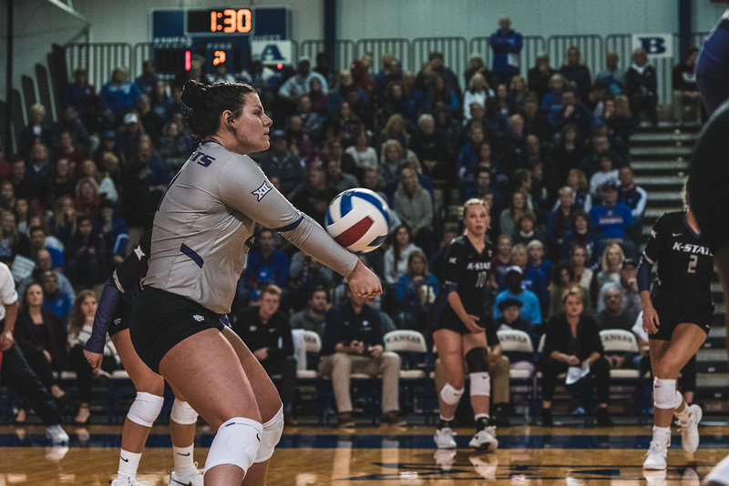 K-State defensive specialist Devan Fairfield successfully sets up the ball after receiving it from KU. K-State beat the Jayhawks 3-2 on November 14, 2018 in Lawrence, KS. (Alex Todd | Collegian Media Group)