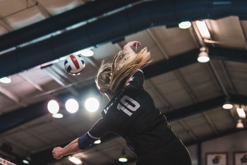 Outside hitter Brooke Heyne slams the ball over the net for one of her 17 kills during the game against KU on November 14, 2018 in Lawrence, KS. K-State beat KU 3-2. (Alex Todd | Collegian Media Group)