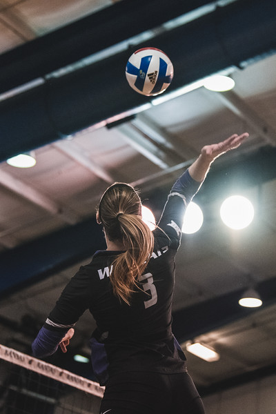 K-State outside hitter Alyssa Schultejans goes to hit the ball over the net to get a kill against KU. K-State beat KU in 3-2 on November 14, 2018 in Lawrence, KS. (Alex Todd | Collegian Media Group)