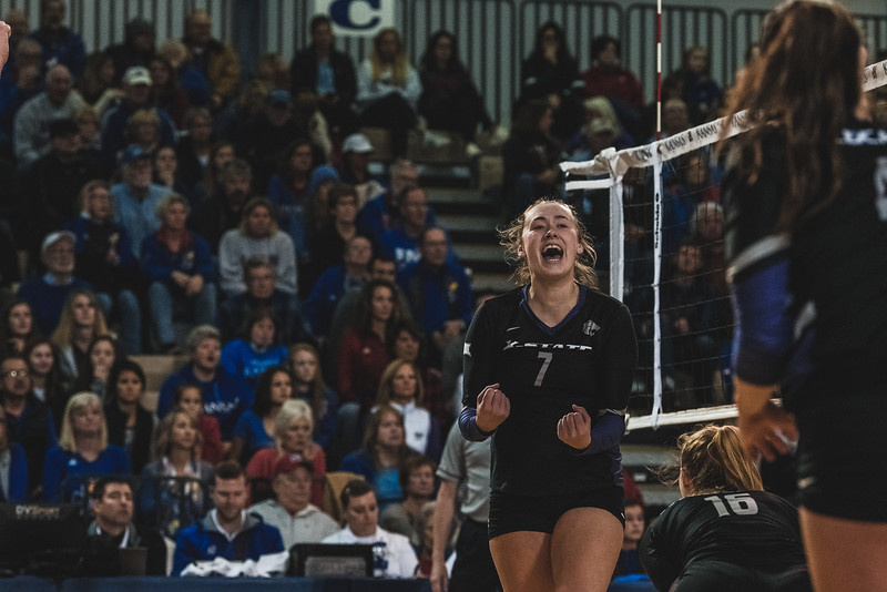 Redshirt senior Kylee Zumach lets out a cry after scoring a kill against KU during Wednesday nights game in Lawrence, KS. K-State ultimately defeated the Jayhawks 3-2. (Alex Todd | Collegian Media Group)