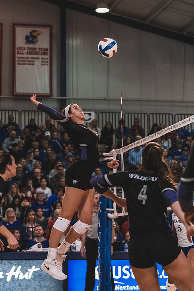 K-State redshirt sophomore Peyton Williams goes on the offensive and scores a kill against KU on November 14, 2018 in Lawrence, KS. (Alex Todd | Collegian Media Group)