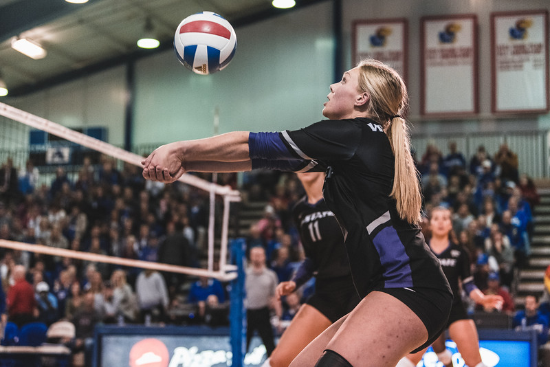 Outside hitter Brooke Heyne sets the ball for a teammate during the game against KU on November 14 in Lawrence, KS. Heyne had a total of 17 kills during the 5 sets against the Jayhawks. (Alex Todd | Collegian Media Group)