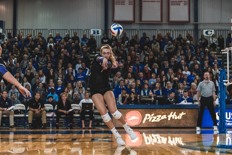 Outside hitter Kylee Zumach doesn't let KU score a kill and bumps the ball to a teammate. K-State defeated the Jayhawks 3-2 in Lawrence, KS. (Alex Todd | Collegian Media Group)