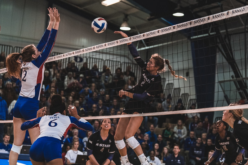 K-State junior Elle Sandbothe launches the ball bast KU's Rachel Langs for a kill during Wednesday nights game in Lawrence, KS. K-State defeated the Jayhawks 3-2. (Alex Todd | Collegian Media Group)