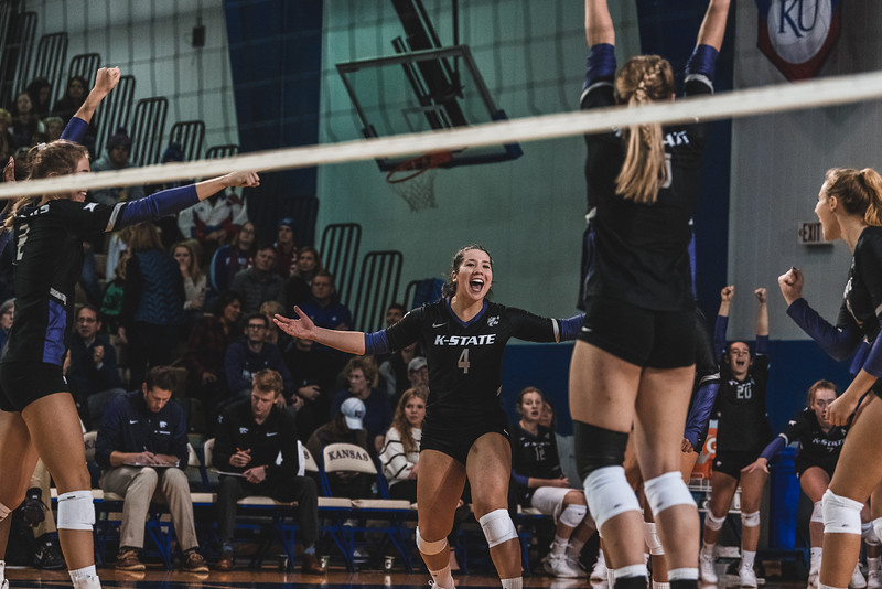 Setter Sarah Dixon celebrates with the team after the Wildcats get a kill. K-State defeated KU 3-2 in Lawrence, KS on November 14, 2018. (Alex Todd | Collegian Media Group)