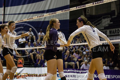 The team celebrates a major stuff block against Iowa State in Ahearn Field House on Sept. 21, 2016. (Sabrina Cline | The Collegian)
