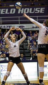 Senior setter Katie Brand sets the ball up for senior middle blocker Katie Reininger against Iowa State in Ahearn Field House on Sept. 21, 2016. (Sabrina Cline | The Collegian)