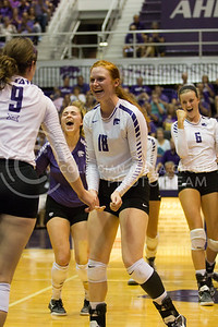 The team celebrates the point won against Iowa State in Ahearn Field House on Sept. 21, 2016. (Sabrina Cline | The Collegian)