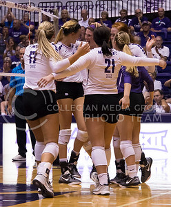 The K-State women's volleyball team celebrates a point against Iowa State in Ahearn Field House on Sept. 21, 2016. (Anna Spexarth | The Collegian)