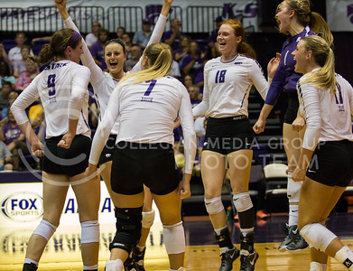 The team celebrates a stuff block by senior middle blocker Katie Reininger in the match against Iowa State in Ahearn Field House on Sept. 21, 2016. (Sabrina Cline | The Collegian)