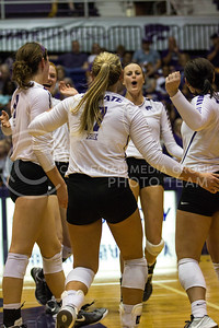 The team celebrates a major point after a long rally against Iowa State in Ahearn Field House on Sept. 21, 2016. (Sabrina Cline | The Collegian)