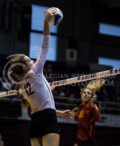 Sophomore middle blocker Macy Flowers hits the ball during the K-State volleyball match against Iowa State in Ahearn Field House on Sept. 21, 2016. (Nathan Jones | The Collegian)
