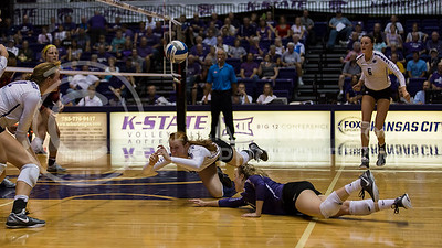 Junior opposite hitter Bryna Vogel and senior libero Kersten Kober dive for the ball during the K-State volleyball game against Loyola in Ahearn Field House on Sept. 10, 2016. (Nathan Jones | The Collegian)