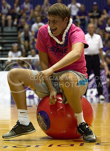 An attendee of the K-State volleyball match against Iowa State bounces across the court during a timeout to win a potential prize on Sept. 21, 2016 in Ahearn Field House.  (Sabrina Cline | The Collegian)