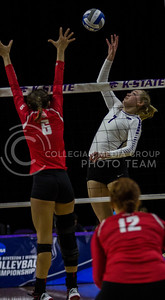 Sophomore outside hitter, Kylee Zumach, tips the ball during the K-State game against Ohio State in Bramlage Coliseum on Dec. 3, 2016. (Sabrina Cline | The Collegian)