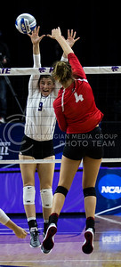 Senior middle blocker Katie Reininger prepares to block the ball during the volleyball game against Ohio State in Bramlage Coliseum on Dec. 3, 2016. (Nathan Jones | The Collegian)