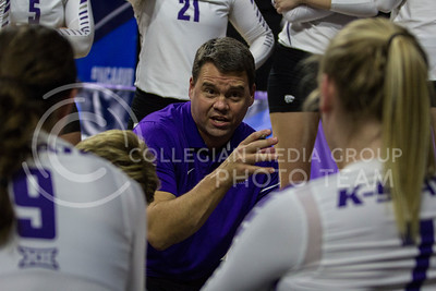 Associate Head Coach, Jeff Grove, talks with the team during a timeout at the K-State game against Ohio State in Bramlage Coliseum on Dec. 3, 2016. (Sabrina Cline | The Collegian)