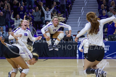 The team cheers after winning a point during the K-State game against Ohio State in Bramlage Coliseum on Dec. 3, 2016. (Maddie Domnick | The Collegian)