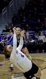 Bryna Vogel, junior opposite hitter, dives to keep the ball alive during the K-State game against Ohio State in Bramlage Coliseum on Dec. 4, 2016. (Sabrina Cline | The Collegian)