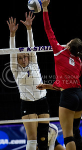 Sophomore outside hitter, Kylee Zumach, goes up to block the ball during the K-State game against Ohio State in Bramlage Coliseum on Dec. 3, 2016. (Sabrina Cline | The Collegian)