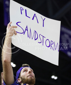 A K-State student holds up a sign during the volleyball game against Ohio State in Bramlage Coliseum on Dec. 3, 2016. (Nathan Jones | The Collegian)