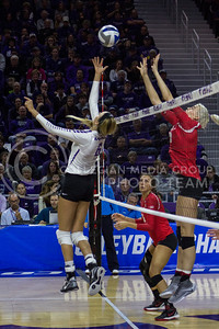 Senior setter Katie Brand tips the ball during the K-State game against Ohio State in Bramlage Coliseum on Dec. 3, 2016. (Maddie Domnick | The Collegian)