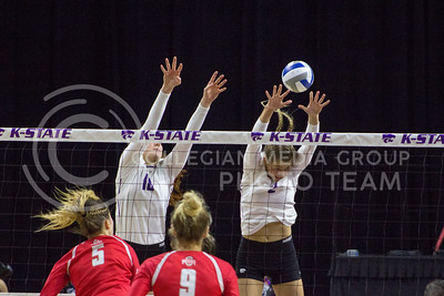 Junior opposite hitter Bryna Vogel and freshman middle blocker Elle Sandbothe block the ball during the K-State game against Ohio State in Bramlage Coliseum on Dec. 3, 2016. (Maddie Domnick | The Collegian)