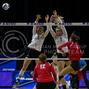Freshman middle blocker Elle Sandbothe and sophomore outside hitter Kylee Zumach block the ball during the volleyball game against Ohio State in Bramlage Coliseum on Dec. 3, 2016. (Nathan Jones | The Collegian)