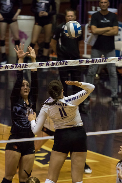 Middle blocker Peyton Williams kills the ball against Oregon State at Ahern Fieldhouse on Sept. 7 2018. ( Sabrina Cline | Collegian Media Group